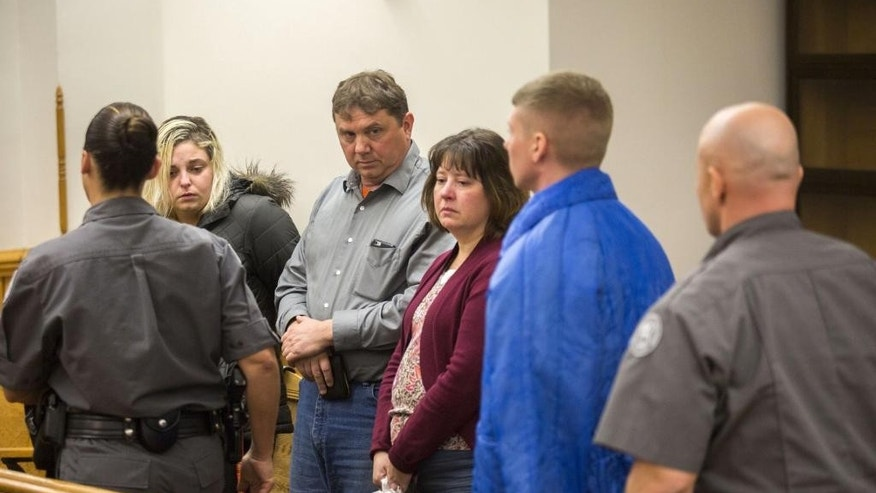 Arial Courtland, Larry Phillips, and Kimberly Phillips watch as Sean Phillips walks past them after his sentencing at the Mason County Courthouse in Ludington, Mich., on Friday, Dec. 9, 2016. Sean Phillips, convicted of second-degree murder in the disappearance of his 4-month-old daughter, was sentenced to 19 to 45 years in prison. He is the son of Larry and Kimberly Phillips. (Emily Brouwer/Muskegon Chronicle via AP)