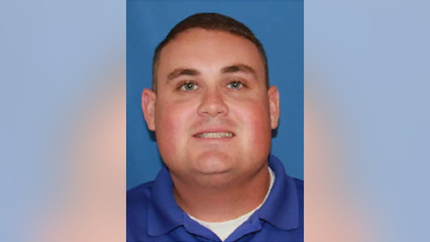 ADDS; UPDATE THAT OFFICER SMITH HAS DIED - This undated image provided by Georgia Southwestern State University shows campus police officer Jody Smith. The manhunt for 32-year-old Minquell Lembrick ended a Thursday, Dec. 8, 2016,  the day after the alleged gunman killed Americus police Officer Nicholas Smarr. Smarr was killed Wednesday by gunfire at an apartment complex in Americus. Officer Jody Smithwas hospitalized with critical wounds. He died Thursday.  (Georgia Southwestern State University via AP)
