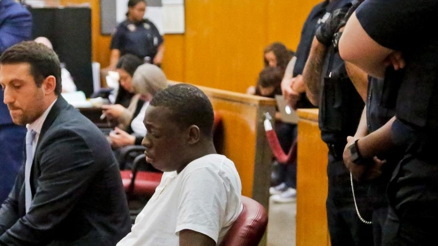 FILE - In this Oct. 19, 2016 file photo, Rapper Bobby Shmurda, whose birth name is Ackquille Pollard, second from left, appears with his lawyer Alex Spiro, left, in a Manhattan court in New York where Shmurda was sentenced to seven years in prison on charges he conspired with a drug gang in several shootings. When a street gang best known for its affiliation with Shmurda turned a Brooklyn neighborhood into a shooting gallery two years ago, New York City police responded with a scalpel instead of an occupying force. It used data to identify and arrest the worst offenders and, working with prosecutors, got them locked up longer - a strategy they claim has brought calm to the neighborhood and helped drive down shootings by 11 percent citywide. (AP Photo/Bebeto Matthews, File)