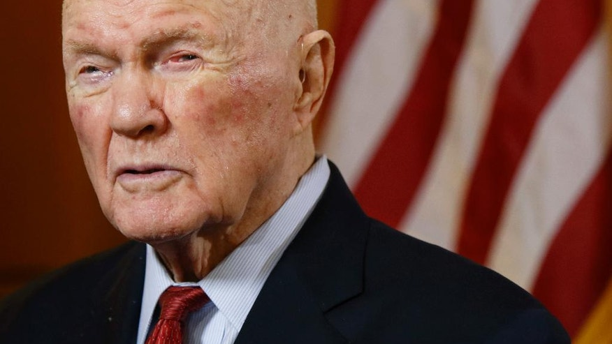 FILE - In this May 14, 2015 file photo, former astronaut and senator John Glenn answers questions during an interview at the Ohio Statehouse. Glenn died Thursday, Dec. 8, 2016, at the age of 95. (AP Photo/Paul Vernon, File)