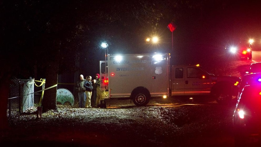 Georgia Bureau of Investigation responds to a shooting involving multiple officers while serving a search warrant at a home in Crawford County, Ga., Monday, Dec. 12, 2016. Authorities said the suspect in the shooting at the home has died. (Woody Marshall/The Macon Telegraph via AP)