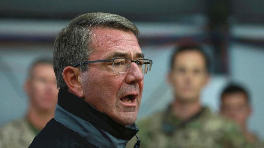 U.S. Defense Secretary Ash Carter speaks to Iraqi and U.S. soldiers at the Qayara air base, that serves as a staging point for the Mosul battle, south of Mosul, Iraq, Sunday, Dec. 11, 2016. Iraqi and U.S.-led coalition forces have killed or gravely wounded more than 2,000 Islamic State fighters in the battle for Mosul since October, Carter said Sunday. Recapturing the city, Iraq's second-largest, is crucial to the Iraqis' hopes of restoring their sovereignty, although political stability will likely remain a challenge afterward. (AP Photo/Hadi Mizban)