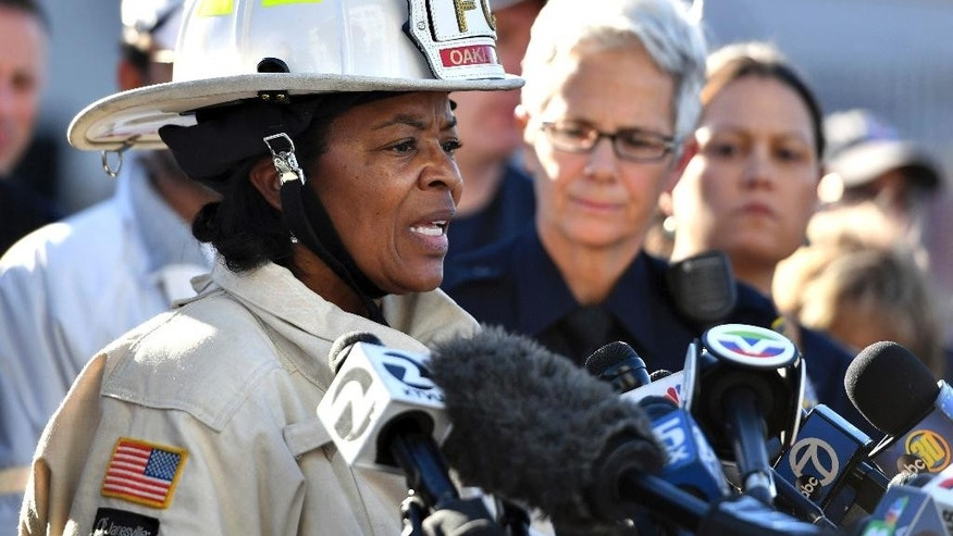 FILE - In this Dec. 3, 2016, file photo, Oakland Fire Chief Teresa Deloach Reed speaks to members of the media after a deadly fire tore through a warehouse during a late-night electronic music party in Oakland, Calif. Authorities say complaints mounted about the cluttered artists' warehouse in Oakland before a deadly blaze ripped through earlier this month. But Oakland Fire Chief Teresa Deloach Reed says Tuesday, Dec. 13, 2016, there are no city records showing her department received concerns about the building. Former residents, neighbors and others say the warehouse was the subject of numerous calls to 911. Thirty-six people died in the Dec. 2 fire. (AP Photo/Josh Edelson, File)