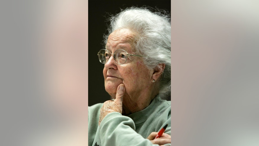 FILE - In this April 23, 2007 file photo, Nola Ochs listens to a lecture during a class at Fort Hays State University in Hays, Kan. Ochs, who became national news when she graduated from college at the age of 95, and continued taking classes until she was 100, died Friday, Dec. 9, 2016, at a senior living home in Dodge City, Kan. She was 105. (AP Photo/Charlie Riedel, File)