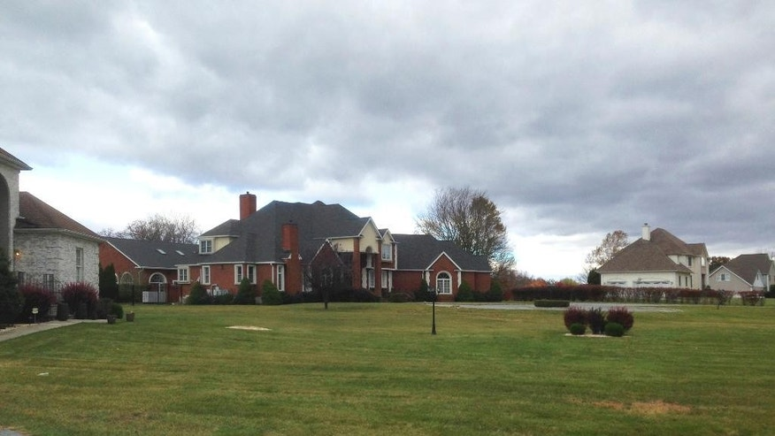 This Oct. 28, 2016 photo shows the home, center, in Greenville, N.Y., where Samy el-Goarany, the son of a successful real estate broker, lived in New York's Hudson Valley before going off to Syria and joining the Islamic State group. When the young man was killed in fighting a year ago, his father told friends his son had died in a car crash, his body so badly burned it couldn't be recovered. But the true story of el-Goarany's death remained a secret until October, when federal prosecutors revealed details in a criminal case against an Arizona man accused of aiding IS by recruiting American fighters. (AP Photo/Jake Pearson)