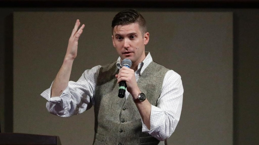 "FILE - In this Dec. 6, 2016 file photo, Richard Spencer speaks at the Texas A&M University campus in College Station, Texas.  Twitter has restored Spencer's personal account less than a month after the social media company suspended it along with other accounts belonging to prominent members of the so-called ""alt-right"" movement. The company told Spencer that it suspended five of his accounts on Nov. 15 for violating a rule against creating multiple accounts with overlapping uses. (AP Photo/David J. Phillip)"
