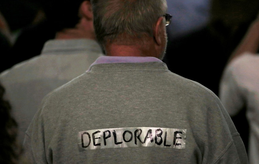 "A supporter of Republican presidential nominee Donald Trump wears tape with the word ""deplorable"" written on it in the audience at a campaign rally in Laconia, New Hampshire, U.S., September 15, 2016.  REUTERS/Mike Segar - RTSNYPD"