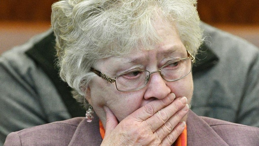 Edward P. Morlock Sr.'s widow, Jeannette A. Morlock, reacts as Ralph DeMasi is arraigned in the 1991 shooting death of Morlock, an armored truck guard,, Wednesday, Dec. 14, 2016, at Worcester Superior Court in Worcester, Mass. (Christine Hochkeppel/Worcester Telegram & Gazette via AP)