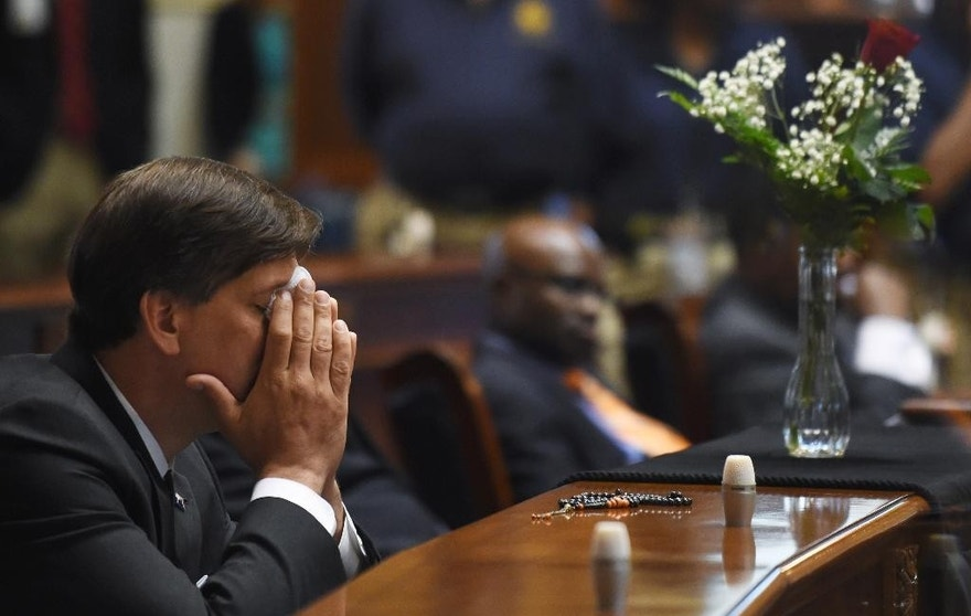 State Senator Vincent Sheheen (D-Kershaw) gets emtional as he sits next to the draped desk of state Sen. Clementa Pinckney, Thursday, June 18, 2015, at the Statehouse in Columbia, S.C.  Pinckney was one of those killed, Wednesday night in a shooting at the Emanuel AME Church in Charleston.  (AP Photo/Rainier Ehrhardt, File)