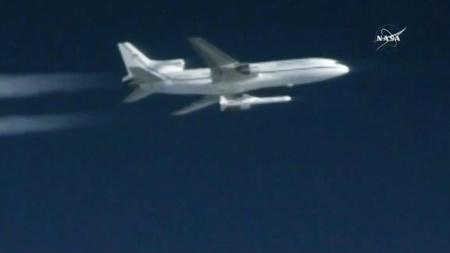 This still image taken from video provided by NASA, a Pegasus rocket containing eight mini-satellites is launched from a plane on Thursday, Dec. 15, 2016, 39,000 feet above the Atlantic, 100 miles east of Daytona Beach, Fla.  Pegasus fired five seconds later, propelling the satellites toward orbit. The $157 million Cyclone Global Navigation Satellite System is meant to improve hurricane forecasting. (NASA via AP)