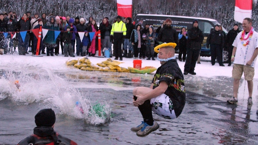 More than a thousand Alaskans took part in a polar plunge fundraiser at Goose Lake, Saturday, Dec. 17, 2016, in Anchorage, Alaska.
