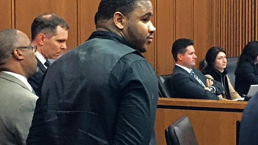 FILE - In this Nov. 4, 2016, file photo, Douglas Shine Jr., center, stands with attorneys as a verdict is read in his trial at the Cuyahoga County Justice Center in Cleveland. Shine was convicted on Nov. 4 of aggravated murder and other charges in a triple homicide at a suburban Cleveland barbershop. A judge in Cleveland is set to announce Monday, Dec. 18, whether she will sentence Shine to death or to life in prison without parole. (AP Photo/Mark Gillispie, File)