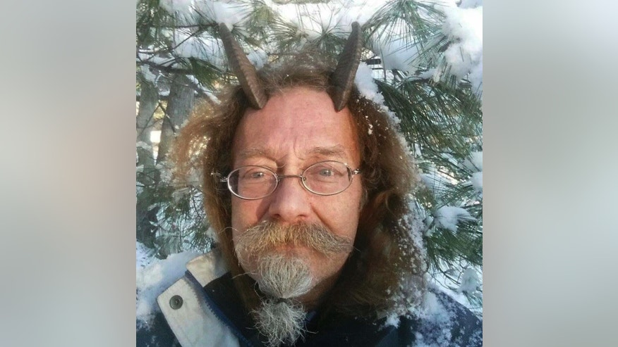 This Dec. 7, 2016, photo provided by Phelan Moonsong shows a portrait of himself in Portland, Maine. Moonsong, an ordained Pagan priest, finally has gotten the OK to sport goat horns in his Maine driver's license photo. Maine resident Moonsong said that unless he's sleeping or bathing, he always wears his goat horns, which serve as his spiritual antennae and help him educate others about Paganism. (Phelan Moonsong via AP)