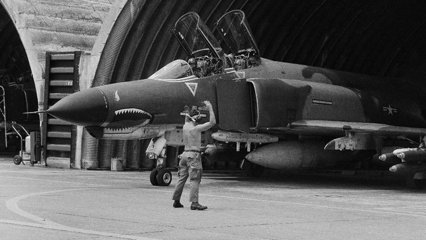 FILE - In this April 23, 1966 file photo a U.S. Air Force F-4 Phantom jet is guided out of its revetment in Da Nang formerly South Vietnam, at the start of a bombing mission over the DMZ area and North Vietnam. The last of thousands of F-4 Phantom jets that have been a workhorse for the U.S. military over five decades are being put to pasture to serve as ground targets for strikes by newer aircraft. (AP Photo, File)