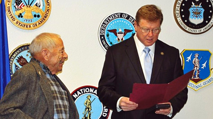 In this Monday, Dec. 19, 2016, photo provided by Stacey Parobek, Nevada Republican Rep. Mark Amodei, right, presents the Medal of Honor to Jerry Reynolds in Reno, Nev.