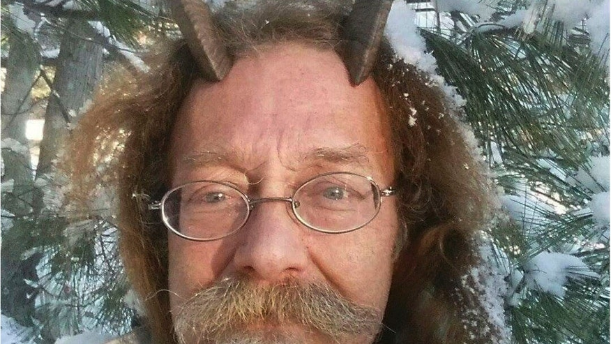 This Dec. 7, 2016, photo provided by Phelan Moonsong shows a portrait of himself in Portland, Maine. Moonsong, an ordained Pagan priest, finally has gotten the OK to sport goat horns in his Maine driver's license photo.