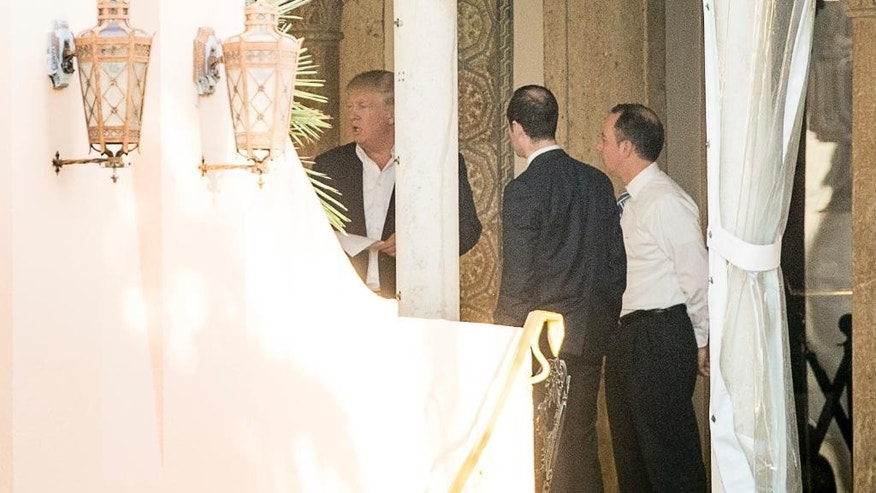 President-elect Donald Trump, left, Stephen Miller, a senior adviser to President-elect Donald Trump, second from right, and Chief of Staff Reince Priebus, right, speak at Mar-a-Lago resort, where Trump is taking meetings, in Palm Beach, Fla., Monday, Dec. 19, 2016. (AP Photo/Andrew Harnik)