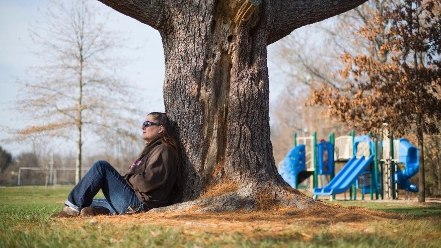 "Teka Russell sits in East Frankfort Park in Frankfort, Ky., on Saturday, Dec. 10, 2016. She has many special memories with her son, D'nomyar ""Denom"" Russell, at the park. The 16-year old was fatally shot on Christmas 2014 by his older brother with a new gun he had received hours earlier; the shooting was ruled to be an accident and no charges were filed. Unintentional shootings spike during the holidays, and are more likely to occur than any other time of the year, according to an analysis by The Associated Press and the USA TODAY Network. (AP Photo/David Stephenson)"