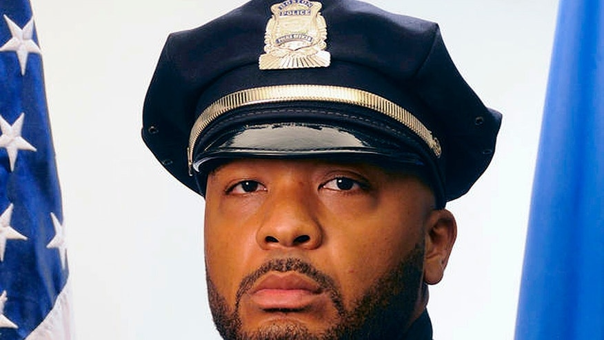 This undated official portrait released by the Boston Police Department shows policer officer Dennis Simmonds, who died on April 10, 2014.