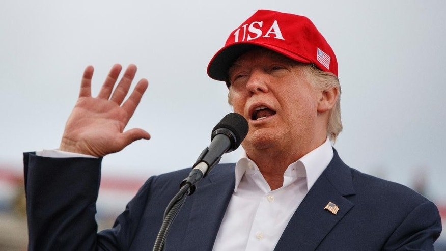 FILE - In this Saturday, Dec. 17, 2016, file photo, President-elect Donald Trump speaks during a rally at Ladd-Peebles Stadium in Mobile, Ala. Trump is poised to meet with his incoming national security adviser on Wednesday, Dec. 20, in the aftermath of a rattling day of violence around the world. (AP Photo/Evan Vucci, File)