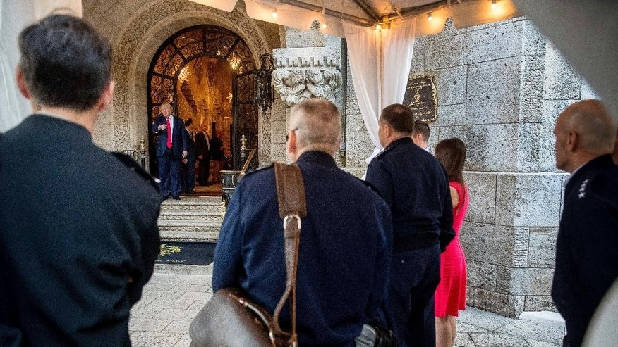 President-elect Donald Trump, second from left, shows out admirals and generals from the pentagon, foreground after a meeting at Mar-a-Lago, in Palm Beach, Fla., Wednesday, Dec. 21, 2016. (AP Photo/Andrew Harnik)