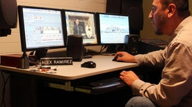 In this Dec. 21, 2016 photo, Alex Ramirez edits footage of the only community-oriented TV show in Spanish in southeast South Dakota at his studio in Sioux Falls, S.D. Ramirez, who voluntarily translates into Spanish news stories and city announcements, recently bought air time with a friend and produce the only community-oriented TV show in Spanish in the region. (AP Photo/Regina Garcia Cano)
