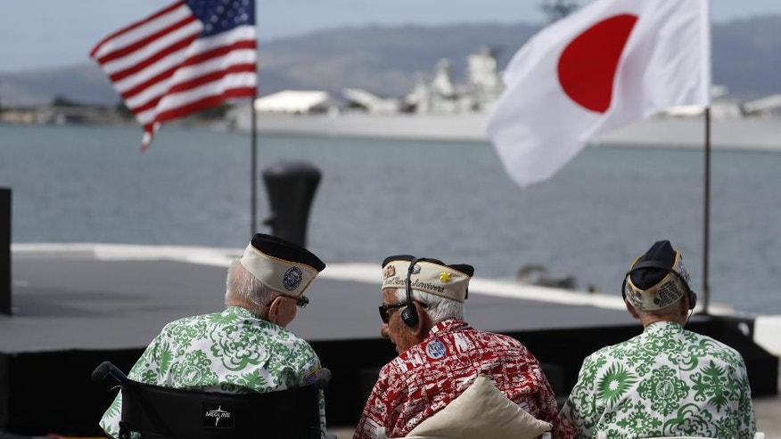 Pearl Harbor survivors wait for President Barack Obama to speak at Pearl Harbor, Hawaii, Tuesday, Tuesday, Dec. 27, 2016, after  President Barack Obama and Japanese Prime Minister Shinzo Abe participated in a wreath laying ceremony at the USS Arizona Memorial. (AP Photo/Carolyn Kaster)