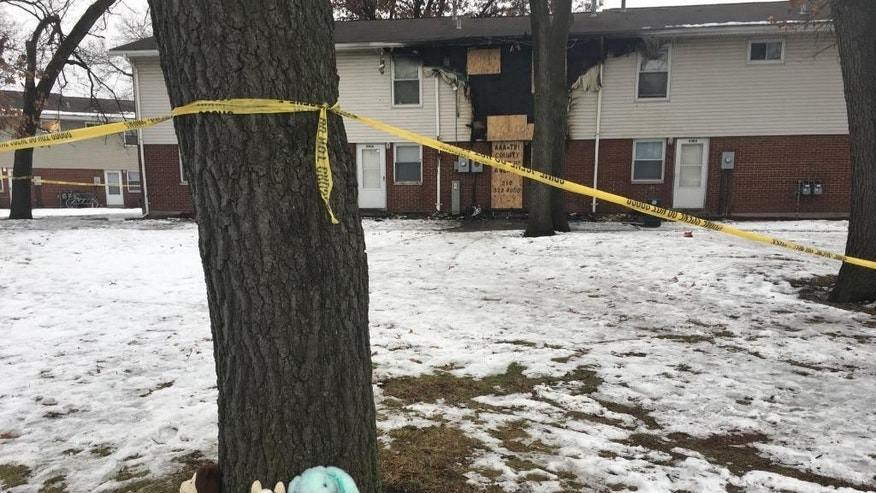 In this Dec. 24, 2016 photo, stuffed animals lie at the foot of a tree near the scene of an apartment fire that took the lives of three children on Dec. 23, in Gary, Ind. Fire official Mark Jones, said Tuesday, Dec. 27, that the fire has been ruled an arson, but an investigation into what started it is ongoing. (Lauren Cross/The Times of Northwest Indiana via AP)
