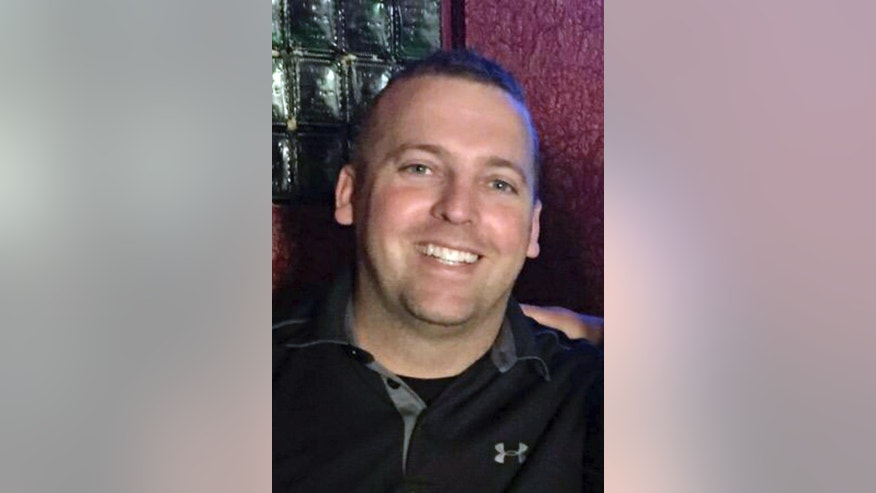 This undated photo provided by the family to the Oregon State Police shows Trooper Nic Cederberg. A Christmas Day shooting left a woman dead, triggered a car chase and gunbattle in suburban Portland that critically wounded Cederberg and killed the slaying suspect, according to authorities and court records Tuesday, Dec. 27, 2016. Cederberg underwent surgery Monday and remains in critical condition. (Cederberg Family/Courtesy of the Oregon State Police via AP)