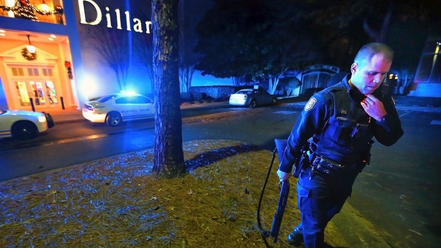 Memphis police officers block off the entrances to the Oak Court Mall on Monday, Dec. 26, 2016, after a disturbance at the mall in Memphis, Tenn.  Authorities and witnesses say there have been disturbances at two malls in Memphis and one of them had to be shut down. (Jim Weber/The Commercial Appeal via AP)