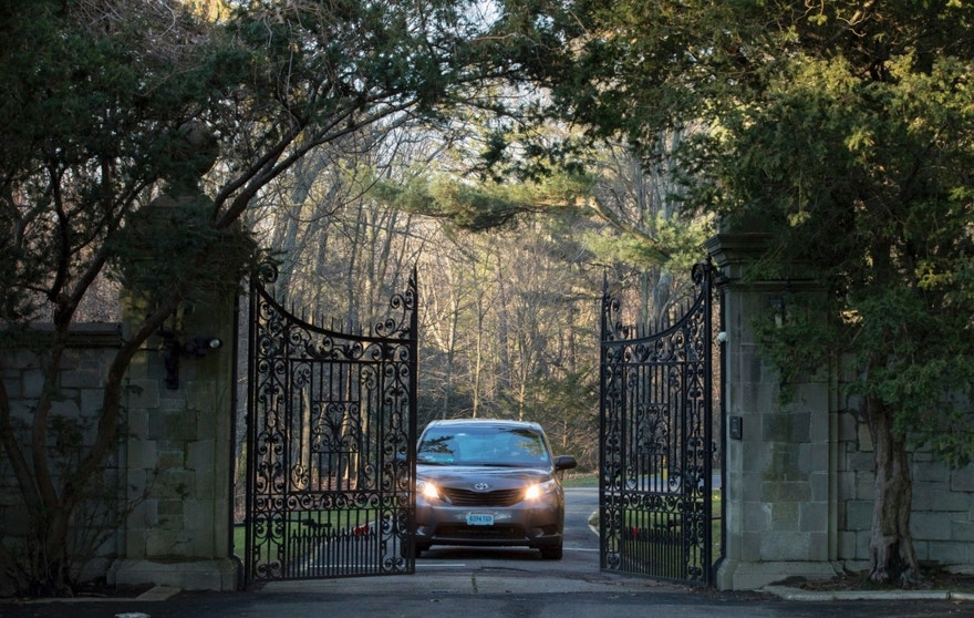 A car with diplomatic license plates drives out of a compound near Glen Cove, N.Y., on Long Island on Friday, Dec. 30, 2016. Russia maintains this and another weekend retreat for its United Nations diplomats about an hour's drive outside New York City — each in one of Long Island's old Gold Coast mansions. U.S. officials didn't clarify which of the two countryside compounds would be closed. (AP Photo/Alexander F. Yuan)