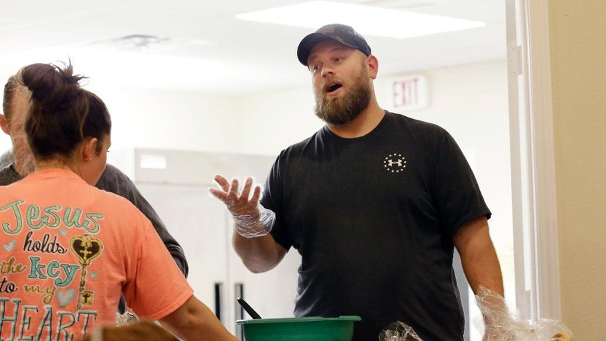 In this Wednesday, Dec. 7, 2016 photo, U.S. Army Veteran Richard Ress, right, speaks while he volunteers at his rural church in Grayson County, Texas. Ress participates in a traveling veterans court with Judge John Roach Jr. The traveling court serves veterans in five counties near Dallas who don't have transportation. Veterans say the opportunity is life-changing.  (AP Photo/LM Otero)