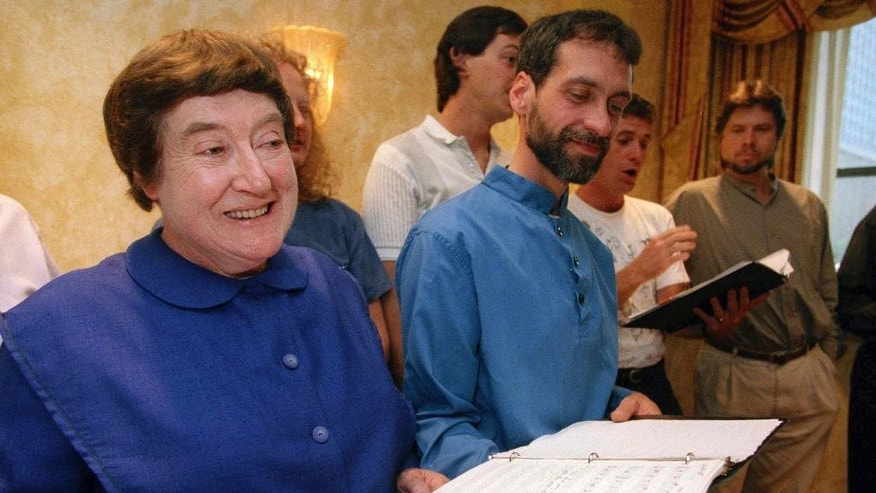 FILE - In this Sept. 13, 1995 file photo, Sister Frances Carr, left, and Brother Arnold Hadd of the Shaker Village in Sabbathday Lake, Maine, sing with the Boston Camerata during a rehearsal at the Warwick Hotel in New York. Carr, one of the last remaining Shakers, died Monday, Jan. 2, 2017, after a brief battle with cancer. She was 89. (AP Photo/Adam Nadel, File)