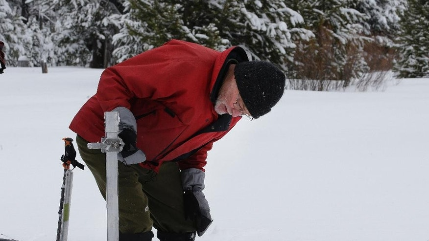 Frank Gehrke, chief of the California Cooperative Snow Surveys Program for the Department of Water Resources, checks the snowpack depth as he conducts the first snow survey of the season at Phillips Station Tuesday, Jan. 3, 2017, in Echo Summit, Calif. The survey showed the snowpack at 53 percent of normal for this site at this time of year.  (AP Photo/Rich Pedroncelli)
