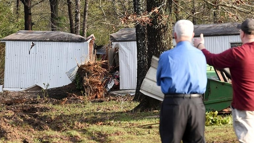 Patrick Davenport, left, and neighbor J.P. Kelley look over the scene of Monday's deadly tornado that claimed the lives of multiple people in Rehobeth, Ala., Tuesday, Jan. 3, 2017. (Danny Tindell/Dothan Eagle via AP)