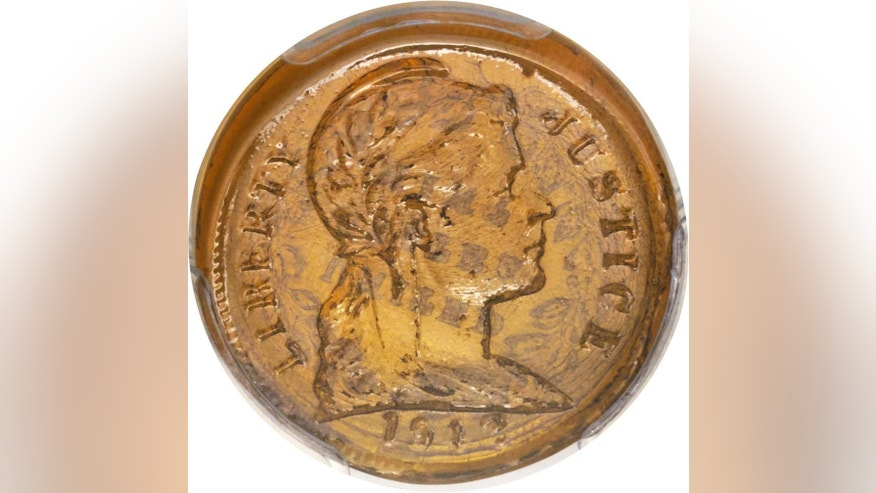 This undated photo provided by Heritage Auctions shows a glass U.S. penny. The rare coin was manufactured as a possible alternative to copper during WWII. The coin is expected to be auctioned in Fort Lauderdale, Fla., Thursday, Jan. 5, 2017. (Matt Poppolo/ Heritage Auctions via AP)