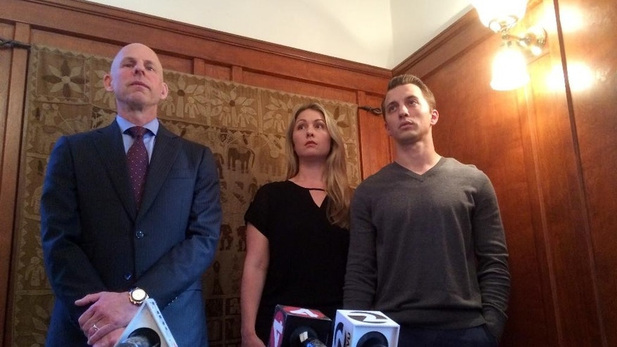 Lawyer Anthony Douglas Rappaport speaks at a news conference with his clients, Denise Huskins and her boyfriend Aaron Quinn, right, in San Francisco, Thursday, Sept. 29, 2016. Matthew Muller, a disbarred Harvard University-trained attorney pleaded guilty Thursday to kidnapping Huskins in a bizarre case that police in California initially dismissed as a hoax. (AP Photo/Sudhin Thanawala)