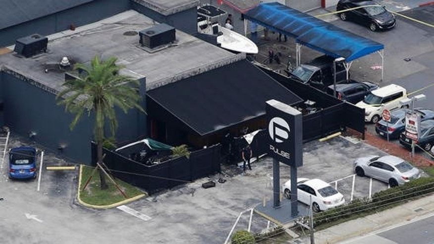 Law enforcement officials at the Pulse gay nightclub in Orlando, Florida, after a mass shooting.