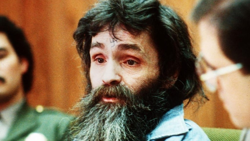 FILE - In this 1986 file photo, Charles Manson is seen in court. Amid reports that Charles Manson has been taken from his California prison cell to a hospital, a state corrections official would confirm only that the 82-year-old killer and cult leader was still alive. Both TMZ and the Los Angeles Times reported Tuesday, Jan. 3, 2017 that Manson had been hospitalized. (AP Photo/File)