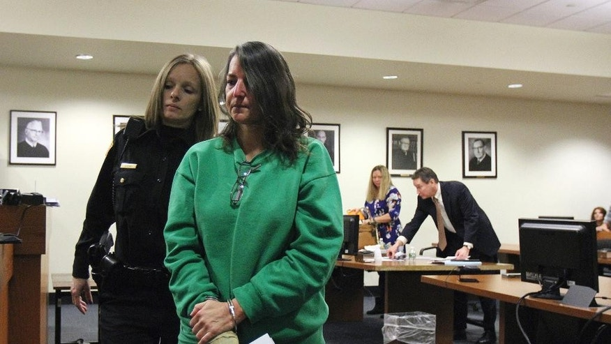 Michelle Lodzinski is escorted from the courtroom after being sentenced to 30 years for the 1991 murder of her 5 year-old son Timothy Wiltsey, Thursday, Jan. 5, 2017, at Middlesex County Court in New Brunswick, N.J. (Tanya Breen/The Asbury Park Press via AP, Pool)