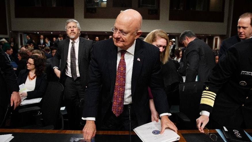 "Director of National Intelligence James Clapper prepares to leave after testifying on Capitol Hill in Washington, Thursday, Jan. 5, 2017, before the Senate Armed Services Committee hearing: ""Foreign Cyber Threats to the United States.""  (AP Photo/Evan Vucci)"