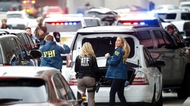 Members of the ATF and FBI arrive at Fort Lauderdale–Hollywood International Airport, Friday, Jan. 6, 2017, in Fort Lauderdale, Fla. A gunman opened fire in the baggage claim area at the airport Friday, killing several people and wounding others before being taken into custody in an attack that sent panicked passengers running out of the terminal and onto the tarmac, authorities said. (AP Photo/Wilfredo Lee)
