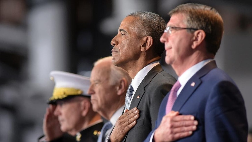 President Barack Obama, stands with, from left, Joint Chiefs Chairman Gen. Joseph Dunford, Vice President Joe Biden, and Defense Secretary Ash Carter, as they listen to the National Anthem during an Armed Forces Full Honor Farewell Review for the president, Wednesday, Jan. 4, 2017, at Conmy Hall, Joint Base Myer-Henderson Hall, Va. (AP Photo/Susan Walsh)
