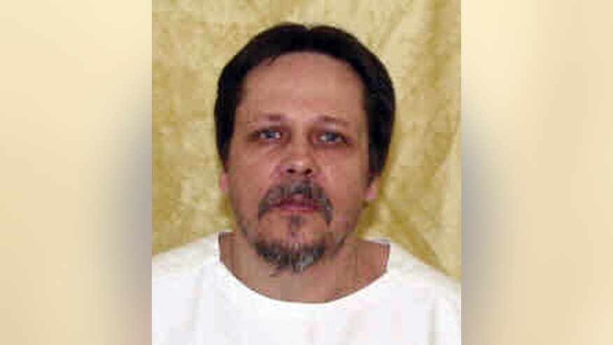 FILE – This undated file photo provided by the Ohio Department of Rehabilitation and Correction shows Dennis McGuire, executed in January 2014 for the 1989 rape and stabbing death of a recently married pregnant woman. McGuire repeatedly gasped and snorted during the 26 minutes it took him to die using a two-drug combination. Federal Magistrate Judge Michael Merz in Dayton, Ohio, is hearing evidence in a weeklong trial over Ohio's newest lethal injection method using three drugs. Ronald Phillips, convicted of the 1993 rape and murder of his girlfriend's 3-year-old daughter in Akron, Ohio, is scheduled for execution on Feb. 15, 2017. (Ohio Department of Rehabilitation and Correction via AP, File)