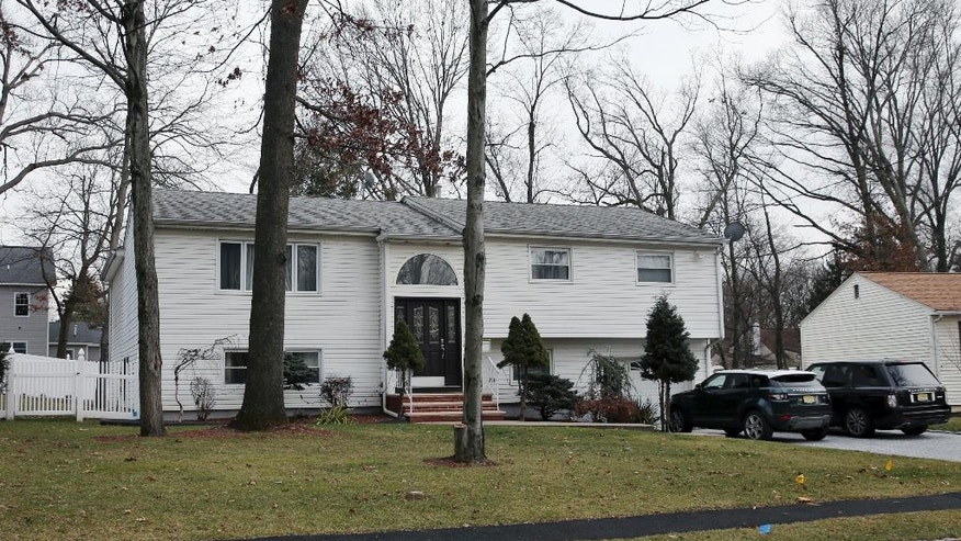 In this Jan. 5, 2017, photo, the home of Dan Zhong is seen in Livingston, N.J. Zhong, a businessman imprisoned on charges that he forced immigrant laborers to do construction at Chinese diplomatic facilities in the U.S. wants permission to turn his New Jersey home into a private jail where he can comfortably await trial. (AP Photo/Mel Evans)
