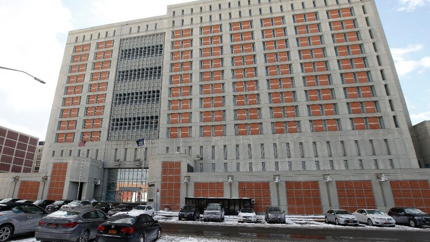 The Metropolitan Detention Center (MDC) is shown Sunday, Jan. 8, 2017, in the Brooklyn borough of New York. Dan Zhong, a businessman imprisoned on charges he forced immigrant laborers to do construction at Chinese diplomatic facilities in the U.S., wants to turn his New Jersey home into a private jail where he can comfortably await trial. For now Zhong is a prisoner at the MDC. (AP Photo/Kathy Willens)