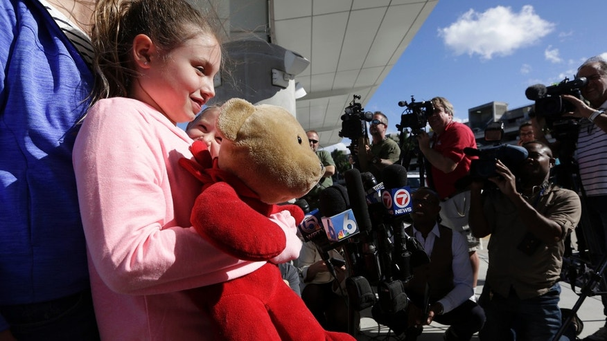 Courtney Gelinas talks with the news media after being reunited with her bear Rufus, at the Fort Lauderdale-Hollywood International Airport, Tuesday, Jan. 10, 2017, in Fort Lauderdale, Fla