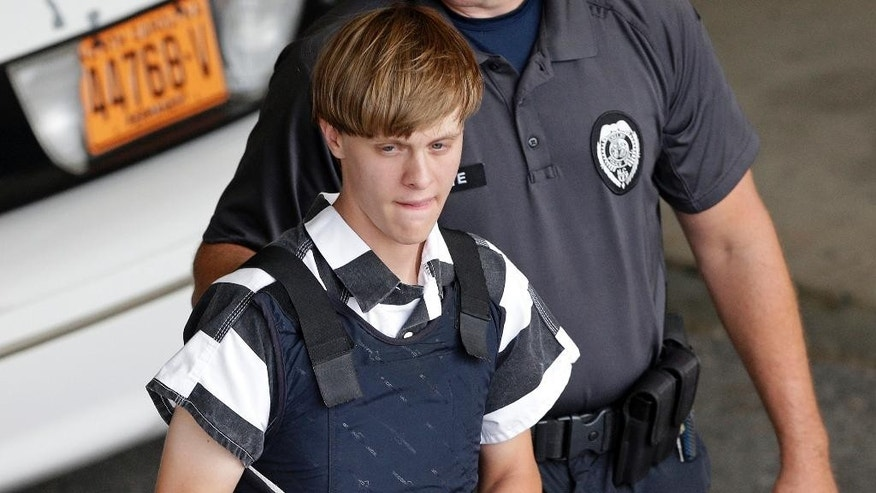 FILE - In this June 18, 2015 file photo, Charleston, S.C., shooting suspect Dylann Roof is escorted from the Cleveland County Courthouse in Shelby, N.C. A federal jury has sentenced Roof to death for killing nine black church members in a racially motivated attack in 2015. (AP Photo/Chuck Burton, File)