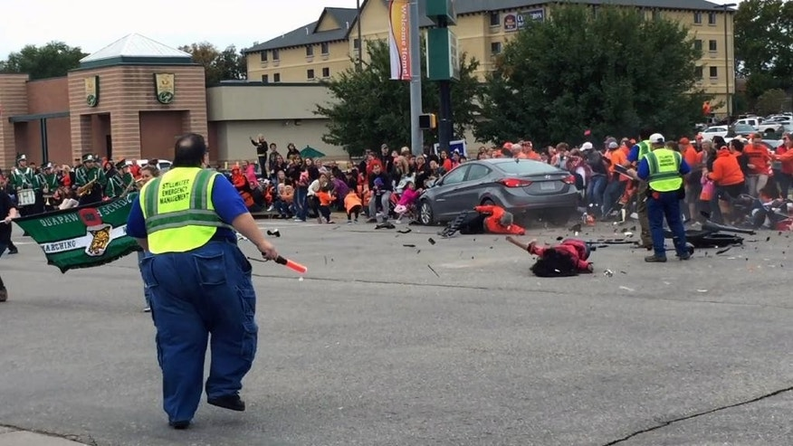 FILE -This Oct. 24, 2015 FILE image taken from video shows the scene in Stillwater, Okla. as a car crashes into spectators at Oklahoma State University's homecoming parade. The trial for the driver, Adacia Chambers who is charged with four counts of second-degree murder and 46 counts of felony assault begins Tuesday, Jan. 10, 2017 in Stillwater. (Connor J. Greco via AP, File)
