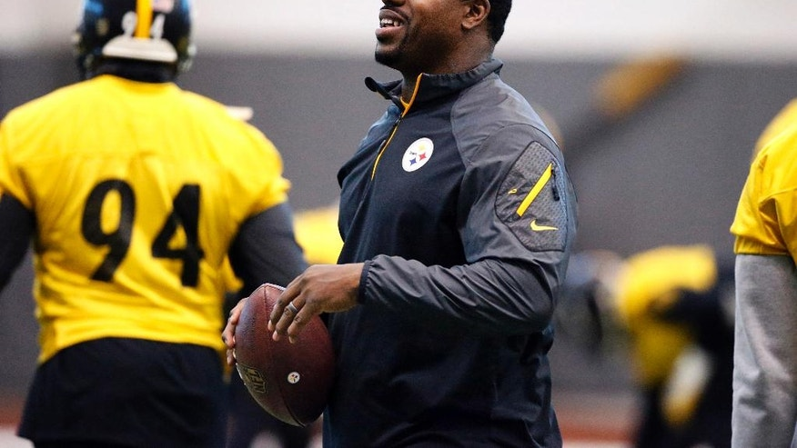 FILE- In this Jan. 13, 2016, file photo, Pittsburgh Steelers assistant coach Joey Porter runs a drill during the NFL football teams' practice in Pittsburgh. Porter has been arrested at a Pittsburgh bar following the team's wild-card win over the Miami Dolphins on Sunday, Jan. 8, 2017. (AP Photo/Gene J. Puskar, File)